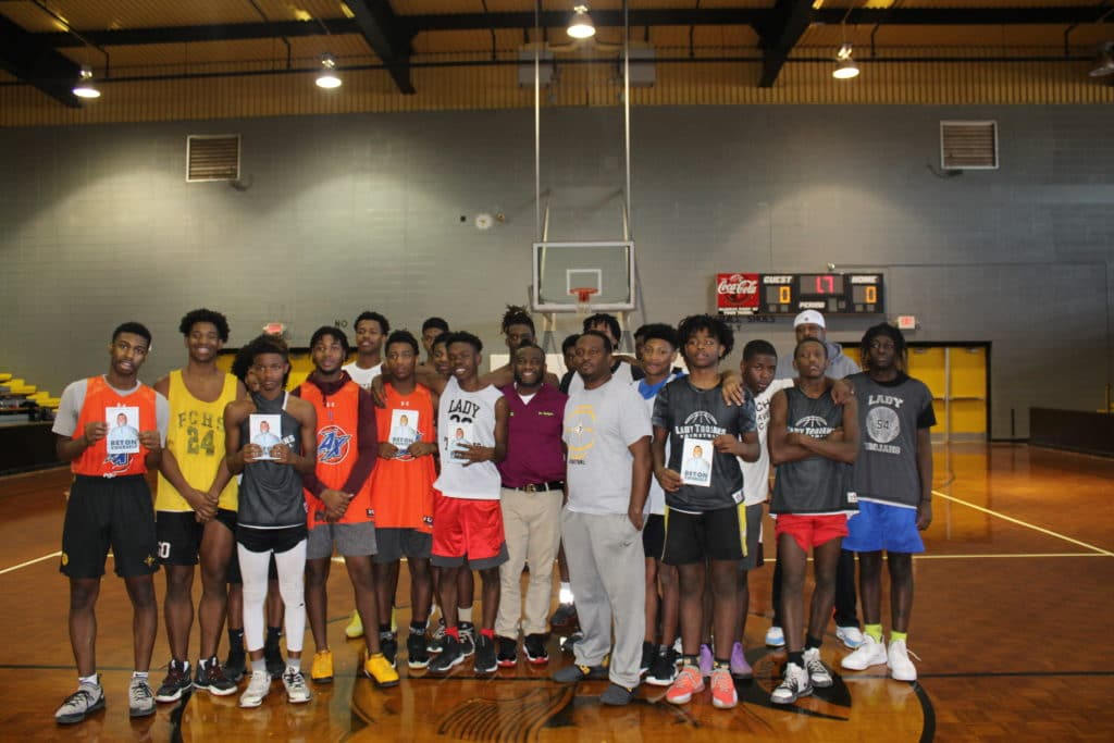 Dr. Hodges with basketball players in a gym
